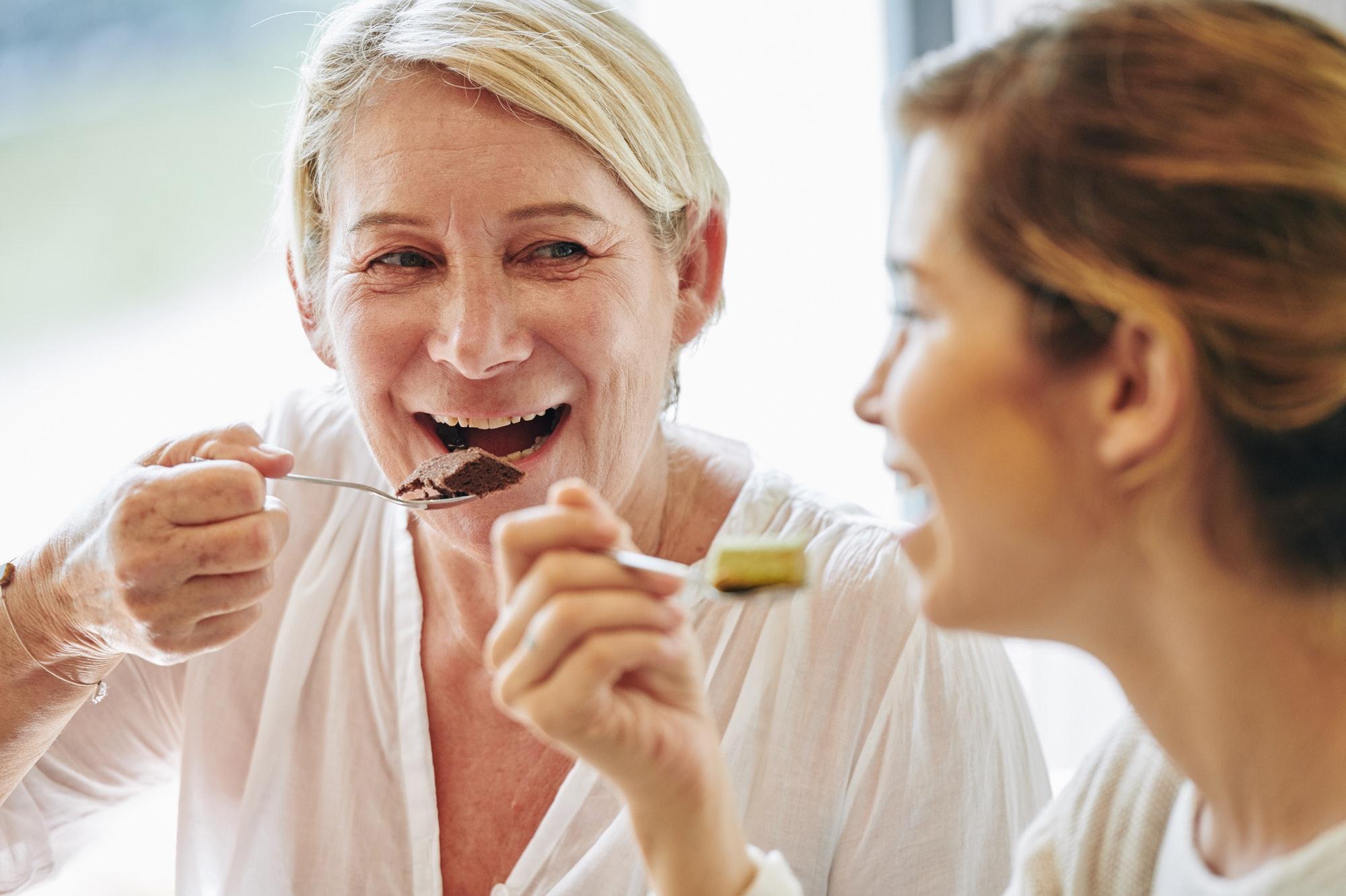 Mature woman eating dessert