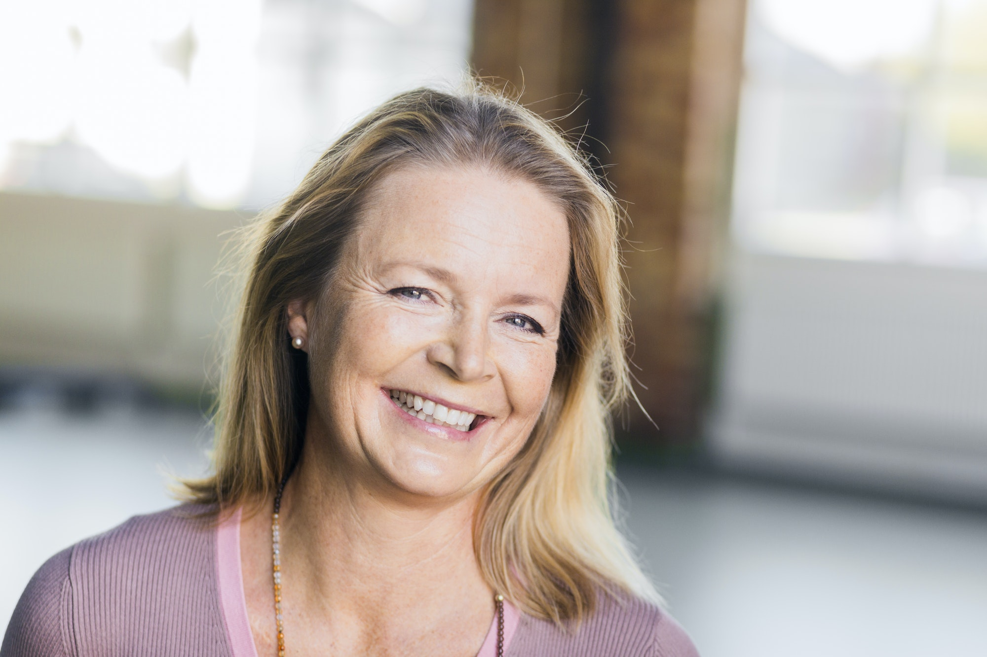 Portrait of mature woman smiling in gym
