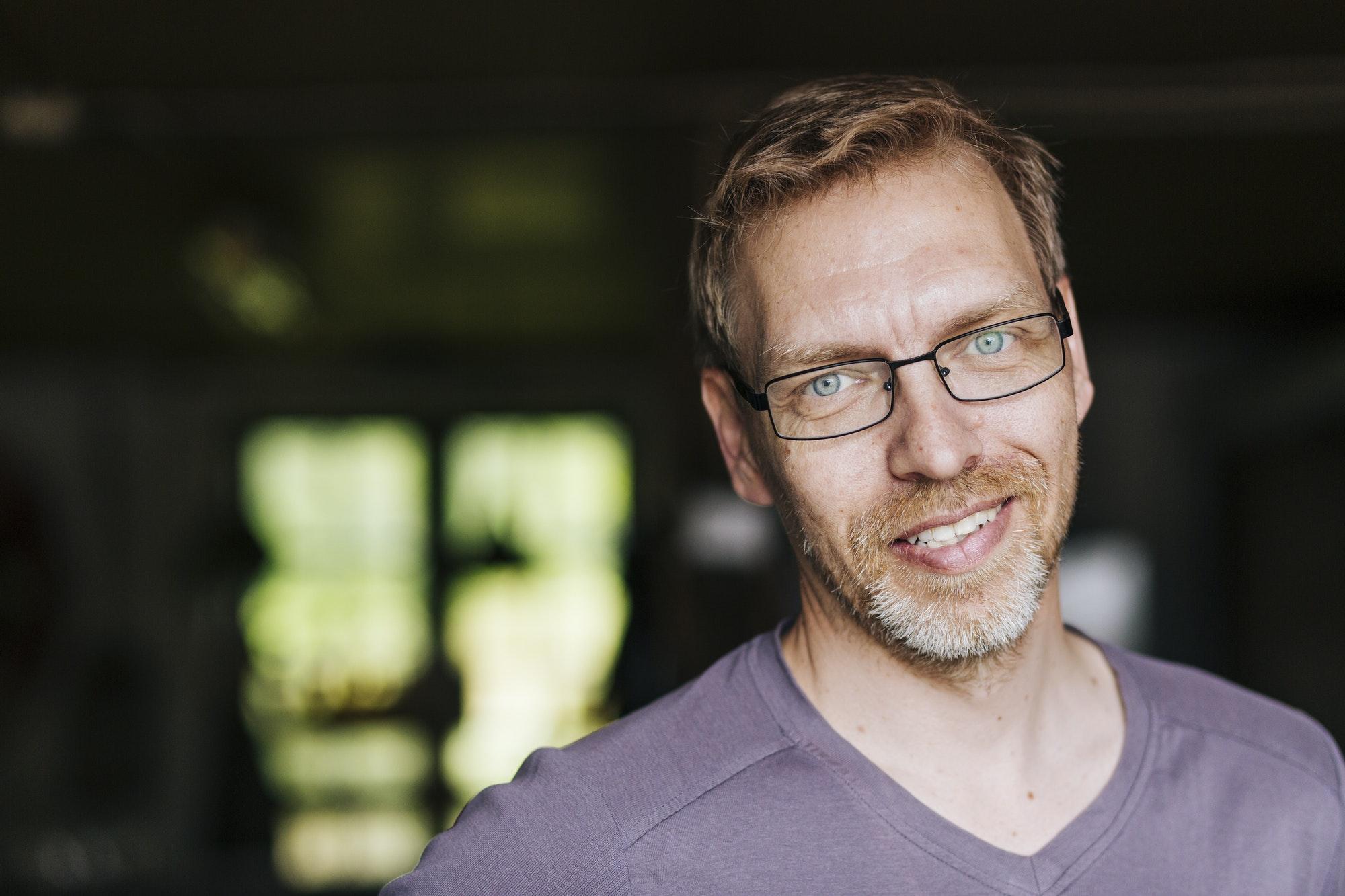 Portrait of smiling man wearing eyeglasses