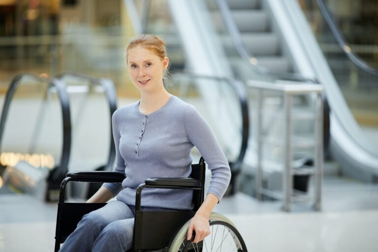 Young woman in wheelchair in shopping mall