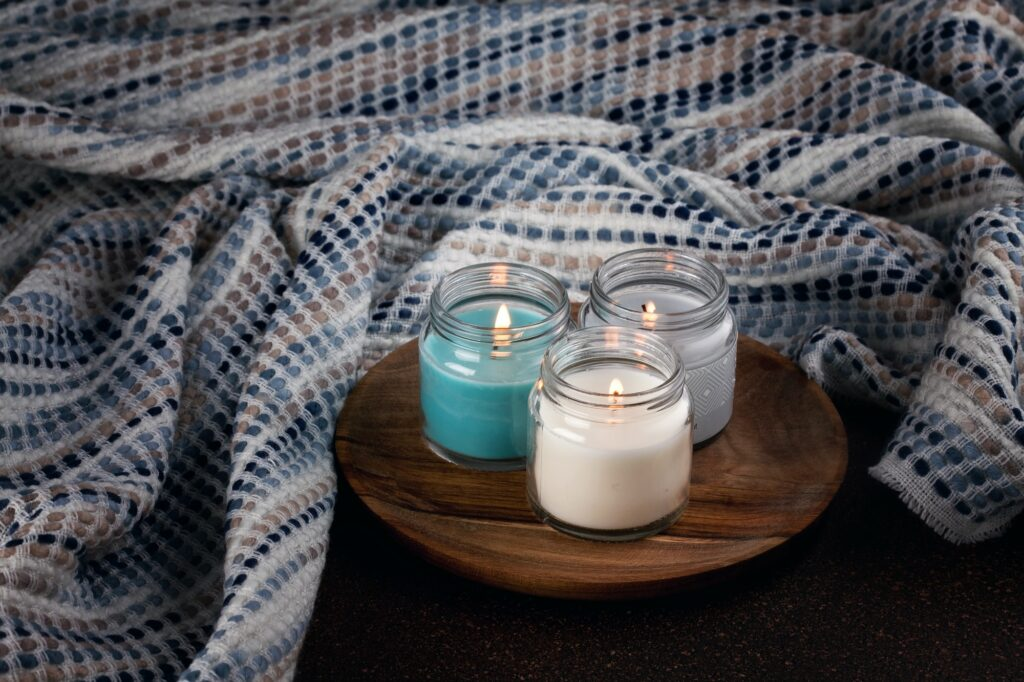 Candles for cold weather. Cosy winter evening or winter holidays celebration concept
