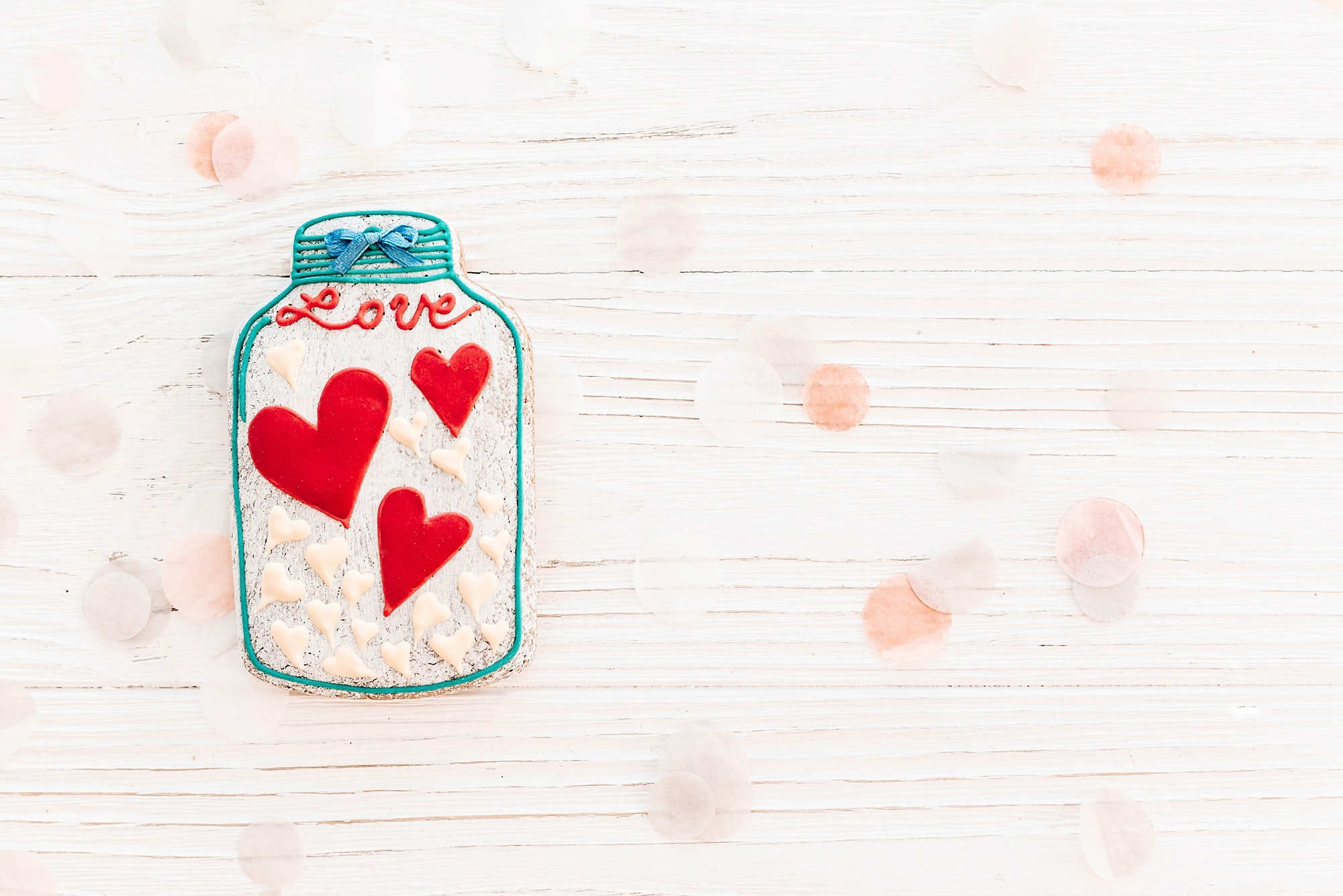 jar with colorful cookie hearts