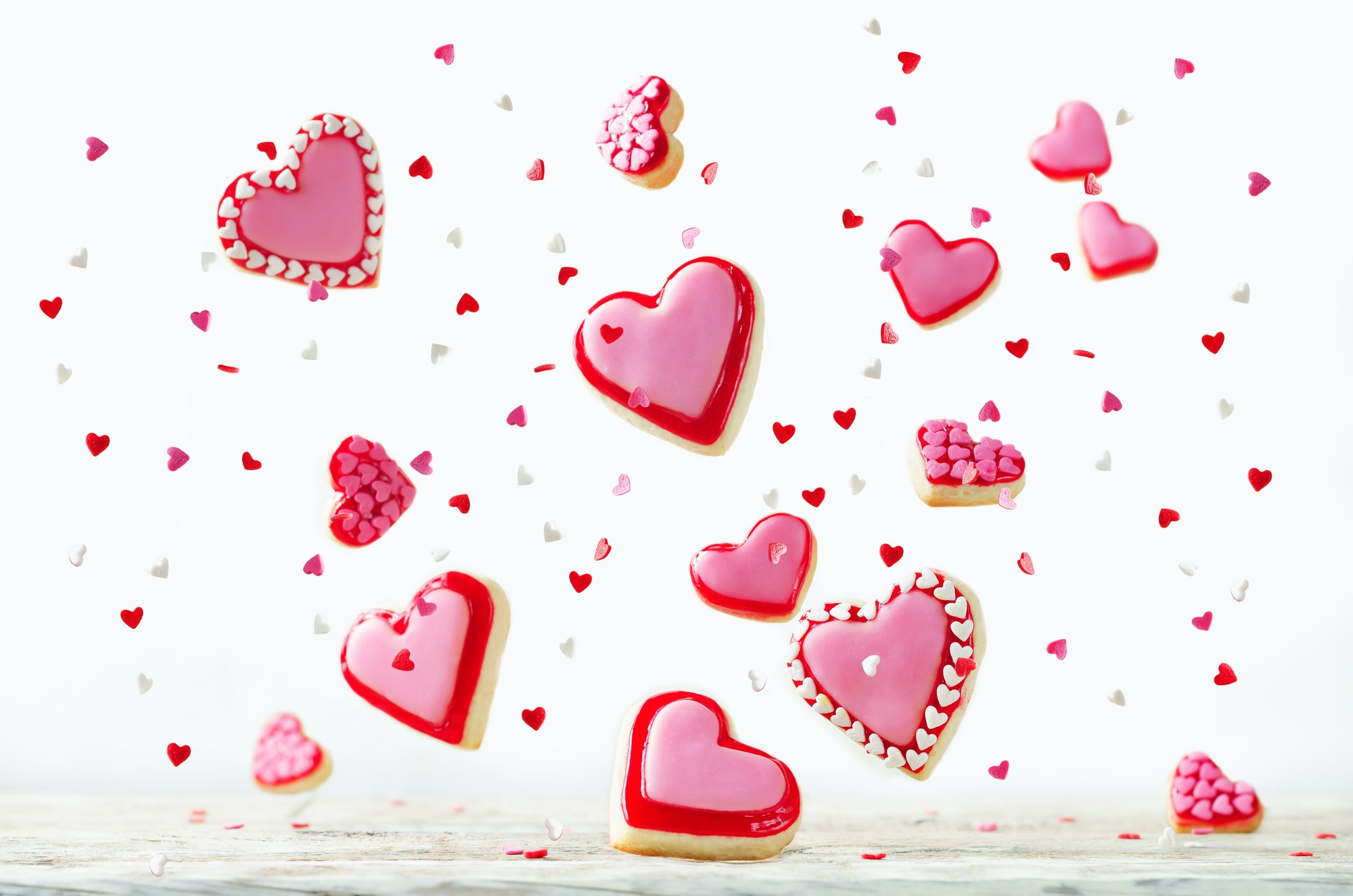 Heart shape flying sugar cookies with pink glaze for Valentine's