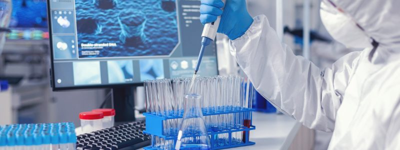 Micropipette used by medical researcher in laborator