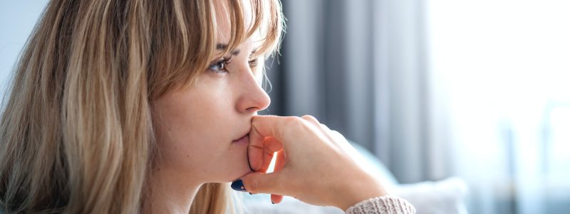 Woman at home deep in thoughts thinking and planning